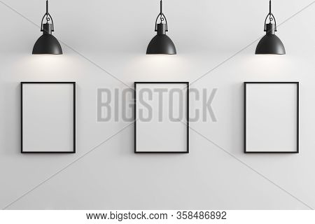 Three Black Vertical Frames Mockup With Black Pendant Lights Above And White Wall, Gallery Concept,