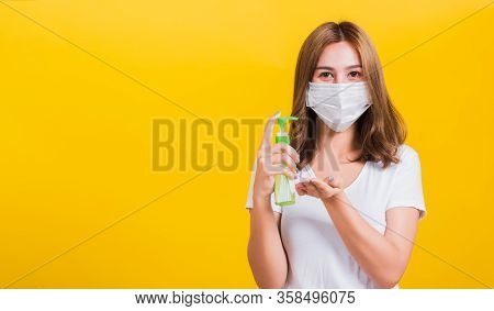 Portrait Asian Thai Beautiful Young Woman Wear Mask Protection Clean Corona Virus On Hand With Alcoh