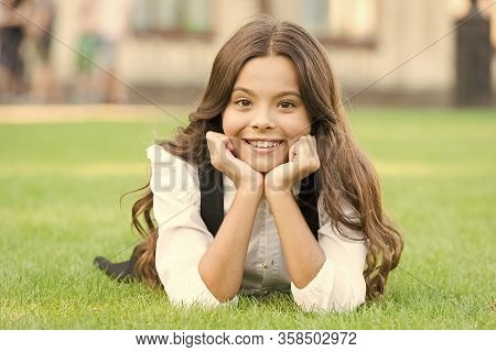 Future Woman. Happy Girl Back To School. Small Girl Relax On Green Grass. Little Girl Smile With Lon