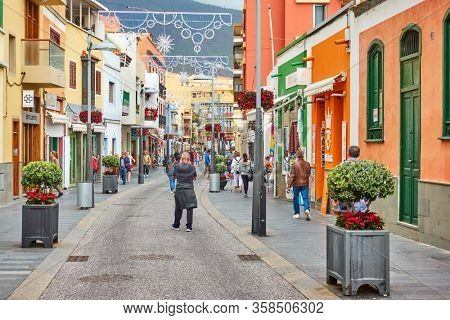 Candelaria, Tenerife, Spain - December 12, 2019: Street in Candelaria town with walking people