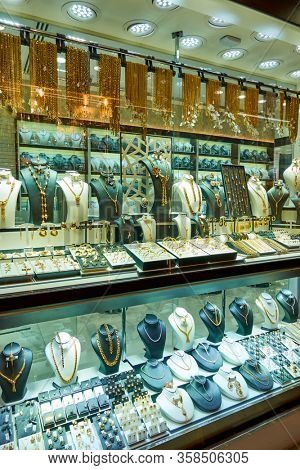 Dubai, UAE - January 31, 2020: Shop window of a jewelery store with gold ware at the Golden Souk market in Dubai, United Arab Emirates