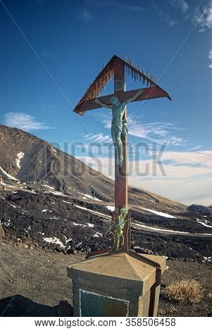 crucifix on meridional volcanic area of Etna Summit Craters in Sicily
