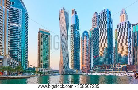 Dubai, UAE - January 30, 2020: Towers of Dubai Marina at twilight, United Arab Emirates