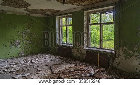 Chernobyl Exclusion And Radioactive Zone. Abandoned Ghost Building. Broken Windows. Chernobyl Histor