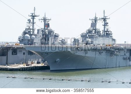 Close View Of Navy Ships In A Military Base Outside Norfolk City In West Virginia.