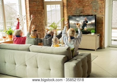 Excited Caucasian Family Watching Female Football Championship, Sport Match At Home. Grandparents, P