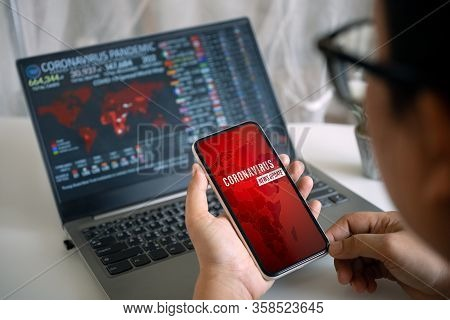 Coronavirus Or Covid-19 Pandemic  News Update Background Concept. Mockup Mobile Phone, A Person Hold