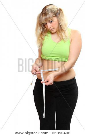 Plus size woman measure her waist belly by metre-stick.