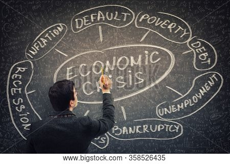 Businessman Analyst Drawing Economic Crisis Scheme And Related Words As Recession And Default. Finan