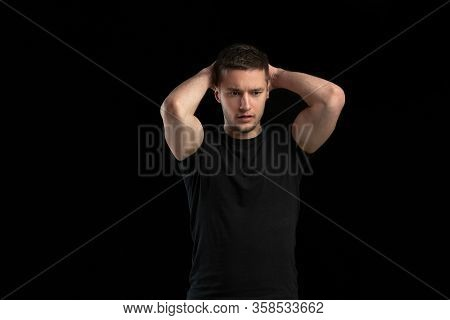 Posing Confident. Monochrome Portrait Of Young Caucasian Man Isolated On Black Studio Background. Be