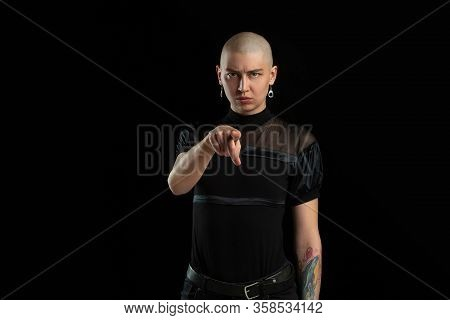 Pointing On, Serious. Monochrome Portrait Of Young Caucasian Bald Woman Isolated On Black Studio Bac