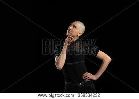 Thoughtful, Dreamful. Monochrome Portrait Of Young Caucasian Bald Woman Isolated On Black Studio Bac