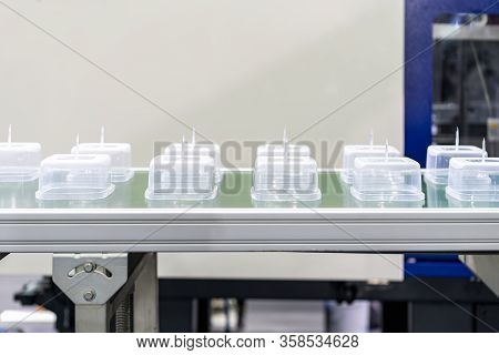 Many  Row Of Clear Plastic Cup Or Box After Made By Plastic Injection Mold Machine On Automatic Conv