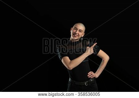 Showing Something. Monochrome Portrait Of Young Caucasian Bald Woman Isolated On Black Studio Backgr