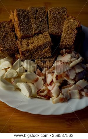 Garlic And Bacon.bacon And Garlic. Bacon And Garlic On A Table On A Blackboard. Food Photography.