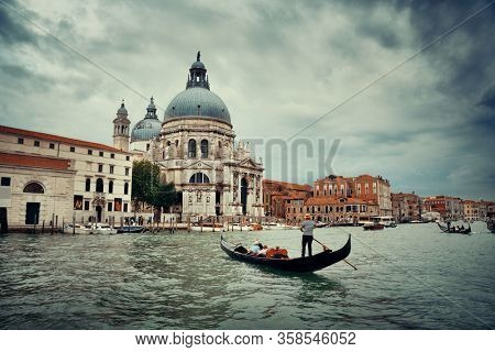 Gondola and Venice  Church Santa Maria della Salute in canal in Italy.