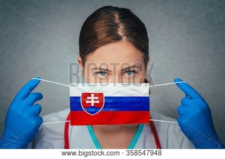 Coronavirus In Slovakia Female Doctor Portrait Hold Protect Face Surgical Medical Mask With Slovakia