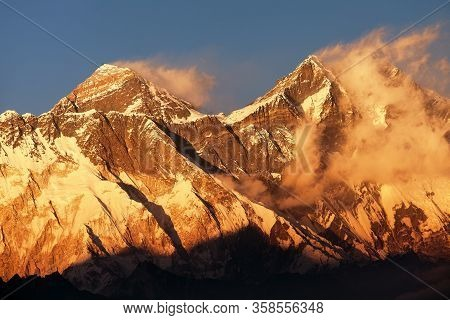 Evening Sunset Red Colored View Of Everest And Lhotse With Beautiful Clouds From Kongde Village, Khu