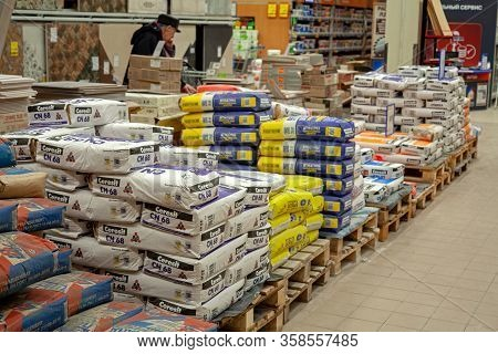 Minsk, Belarus - March 22, 2020: Building Materials Are Sold In A Hardware Store. Bags Of Cement, Pl
