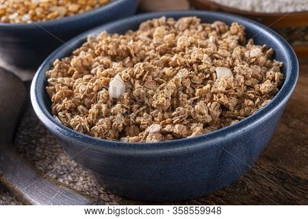 A Bowl Of Delicious Homemade Dry Granola With Almonds.
