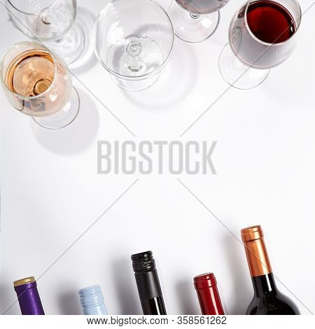Wine glass and bottle top view on white background