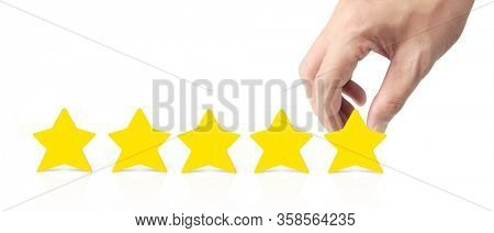 Hand of putting increase five a star shape.The best excellent business services rating customer experience concept