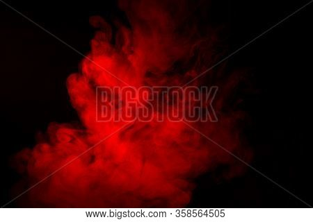 Colorful Smoke Close-up On A Black Background. Red Cloud Of Smoke.