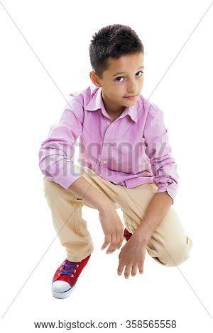 Dark Hair Teenager Boy Leaning On His Knee, Studio Shot, Isolated On White, Full Body.