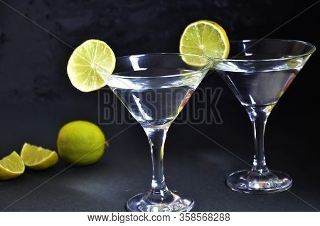 Two Glasses For Making Margarita Cocktails With Lime On A Black Background Margarita Cocktails Shot
