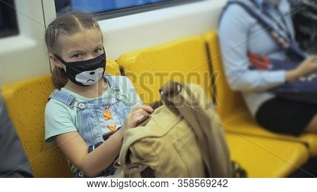 Little Girl Travel Caucasian Ride At Overground Train Airtrain With Wearing Protective Medical Red M