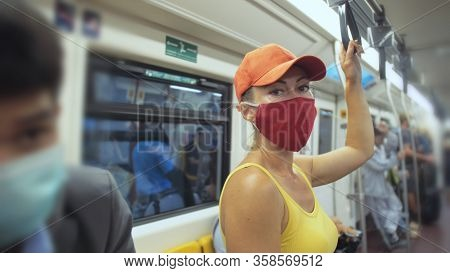 Woman Travel Caucasian Ride At Overground Train Airtrain With Wearing Protective Medical Mask. Girl