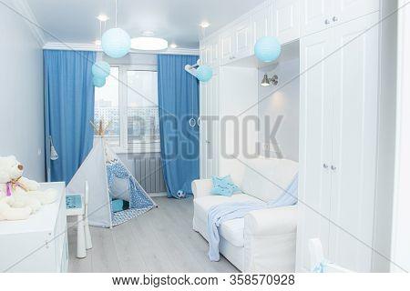 White Childrens Room . Snow-white Bedroom. Interior Of A Modern Apartment. Light Furniture. Advertis