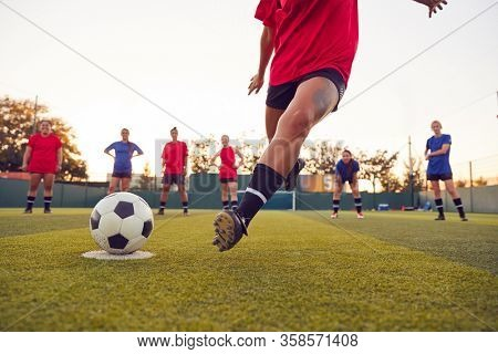 Close Up Of Player Taking Penalty During Womens Soccer Match