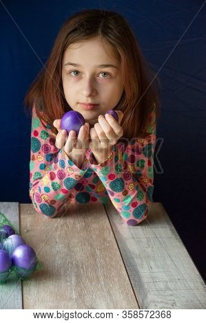 Happy Easter. Girl And Colored Eggs In Purple. Traditions Of Easter. Teenager, Girl 9 Years Old. Gir