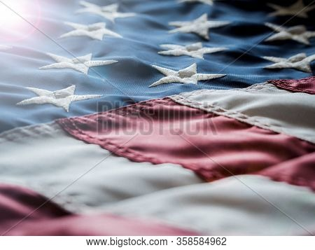 American Flag Or United States Of America Flag Waving In The Wind With Blue Sky And Is A Symbol Of P