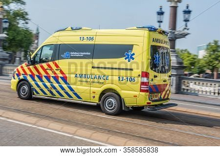 Amsterdam, Holland, Netherlands, August 2018, Ambulance Speeding Through The Centre Of Amsterdam Nea