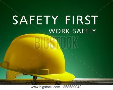 Safety first concept yellow hard safety wear helmet hat -with text safety first