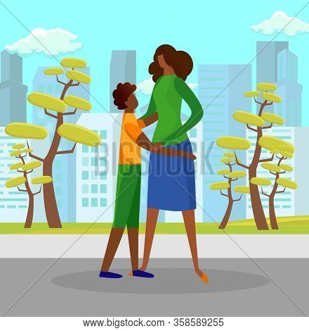 Teenage Boy Watching With Love And Hugging Woman Standing On City Street Background With Skyscrapers