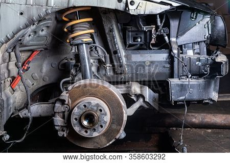 View Of A Disassembled Car, Suspension. Close-up Of A Car Hub, Brake Caliper, Brake Pads, Brake Disc