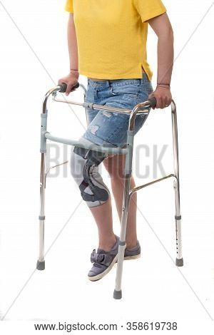 Injuried Young Woman With Walking Frame And Knee Orthosis Isolated On White Background