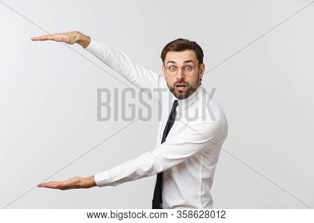 Handsome Young Business Man Happy Smile, Businessman Showing Something On The Open Palm, Concept Of