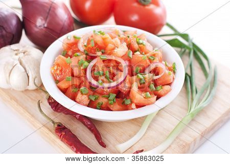 Salsa In A Bowl On A Wooden Board And Ingredients
