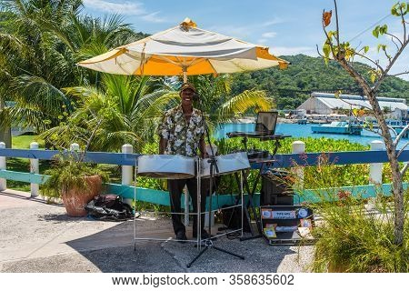 Ocho Rios, Jamaica - April 22, 2019: Local Man Musician Was Playing Songs On A Steel Drums Near The