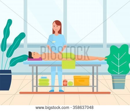Man Getting A Stomach Massage. Professional Masseuse Wearing Uniform And Male Patient Lying On Table