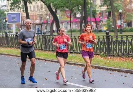 Dnipro, Ukraine - September 16, 2018: Group Of Happy And Smiling Participants Running During 21 Km D
