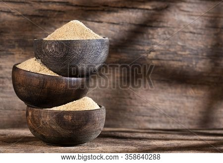 Aphrodisiac Maca Powder - Lepidium Meyenii. Wood Background