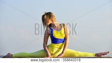 Flexible Girl In Sportswear. Young Attractive Woman Practicing Yoga. Splits Exercise. Leg Muscles St