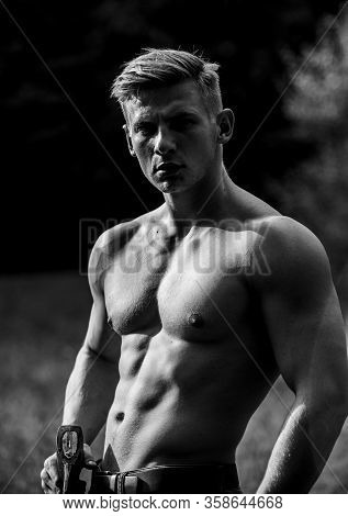 Energy Inside. Sexy Macho Bare Belly Ax. Handsome Shirtless Man With Muscular Body. Muscular Man Wit