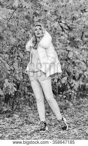 Model Knitwear Clothes Leaves Background. Girl Relaxing In Nature Wearing Knitwear Suit And Jacket.