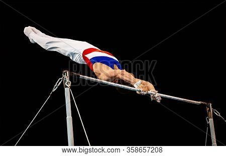 Gymnast Exercise On Horizontal Bar In Gymnastics Competition
